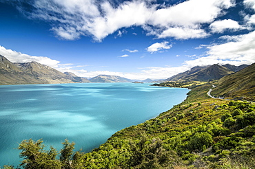 Blue sky with clouds over turquoise lake, Lake Wakatipu, right Glenorchy-Queenstown Road, New Zealand, South Island, Oceania