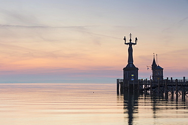 Statue of Imperia at the entrance of the harbour of Konstanz at dawn, historic centre, Konstanz, Baden-Wurttemberg, Germany, Europe