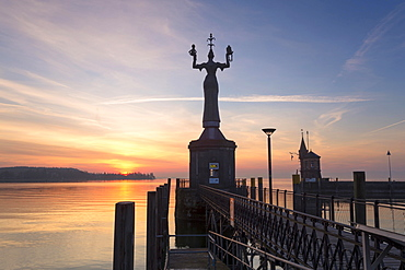 Statue of Imperia at the entrance of the harbour of Konstanz at sunrise, historic centre, Konstanz, Baden-Wurttemberg, Germany, Europe