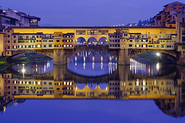 Ponte Vecchio over the Arno with symmetrical reflection in water, Blue Hour, Florence, Tuscany, Italy, Europe