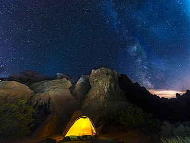 Tent on a campsite with starry sky above and Milky Way, night scene, Valley of Fire, Nevada, USA, North America