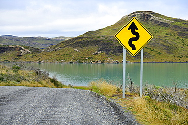 Sign Attention curves along the natural road, Laguna Amarga, Torres del Paine National Park, Última Esperanza Province, Chile, South America