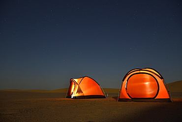 Tents in the Nubian Desert in the evening light, near Dongola, Northern State, Nubia, Sudan, Africa