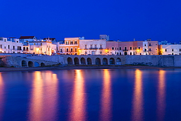 Blue hour, dusk, Seno della Purita city beach, historic centre with the church Chiesa della Purita, Gallipoli, Province of Lecce, Apulia, Italy, Europe