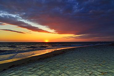 Sunset at sea with cloudy sky, Mari Ermi, Sinis Peninsula, Province of Oristano, Sardinia, Italy, Europe