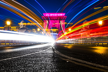Illuminated chain bridge with traces of light at night, Budapest, Hungary, Europe