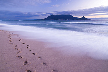 Table Mountain, Lion's Head and Devil's Peak in the evening light, panoramic view of Cape Town, footprints on Bloubergstrand beach, Table Bay in the Atlantic Ocean, Cape Town, Western Cape, South Africa, Africa