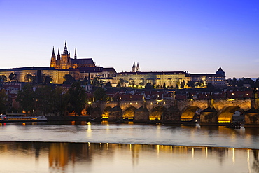 Charles Bridge with Prague Castle and St Vitus Cathedral, dusk, Prague, Czech Republic, Europe