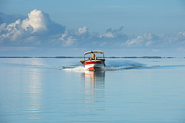 Boat in the waters of Tikehau, Tuamotus, French Polynesia, Oceania