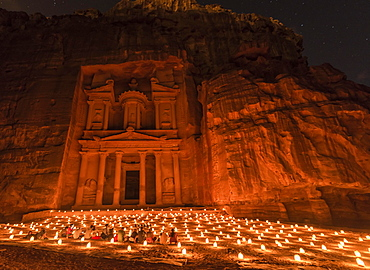 Candles in front of the Pharaoh's treasure house, struck in rock, at night, facade of the treasure house Al-Khazneh, Khazne Faraun, mausoleum in the Nabataean city Petra, near Wadi Musa, Jordan, Asia