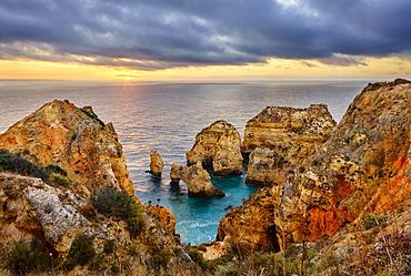 Cliffs of Ponta da Piedade at sunrise, Lagos, Algarve, Portugal, Europe