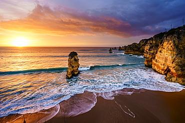 Sunrise on the beach Praia da Dona Ana, Lagos, Algarve, Portugal, Europe