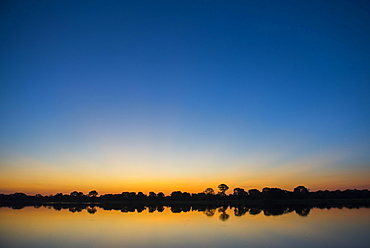 River landscape with Rio Negro at sunset, Fazenda Barranco Alto, Pantanal, Mato Grosso do Sul, Brazil, South America