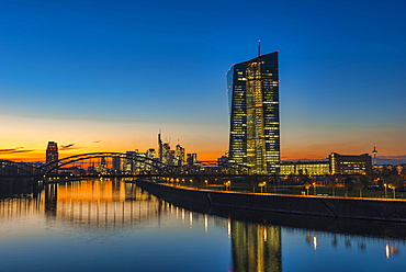 European Central Bank, ECB in front of the illuminated skyline, Osthafenbrucke, dusk, Frankfurt am Main, Hesse, Germany, Europe
