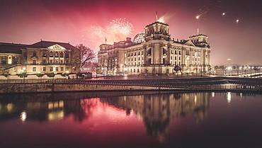 Reichstag bank with fireworks on New Year's Eve, Berlin, Germany, Europe