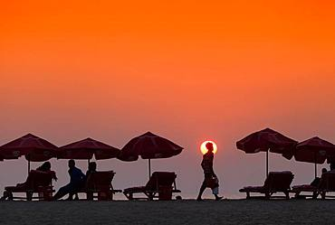 Silhouette of seller of tea on the beach in Cox's Bazar, Bangladesh, Asia