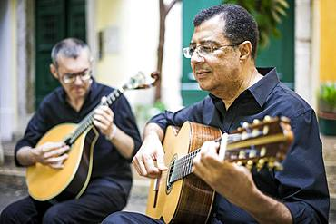 Two fado guitarists with acoustic and portuguese guitars in Alfama, Lisbon, Portugal, Europe
