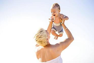 Attractive blond mother with 4 months old baby boy, Portugal, Europe