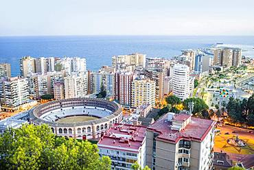 Malaga bullring surrounded by residential buildings next to the sea, Malaga, Spain, Europe