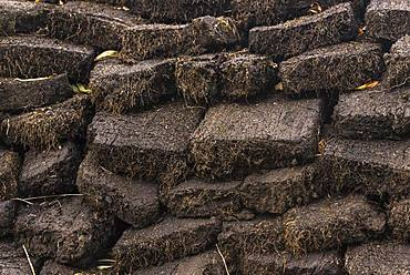 Stacked cut peat in raised bog, Durness, Scottish Highlands, Scotland, Great Britain
