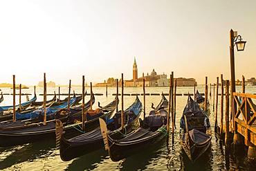 Gondolas in San Marco and Benedictine church of San Giorgio Maggiore on San Giorgio Maggiore island, Venice, Veneto, Italy, Europe