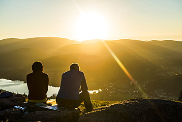 Older couple at Hochfirst with view to Titisee and Feldberg at sunset, near Neustadt, Black Forest, Baden-Wuerttemberg, Germany, Europe