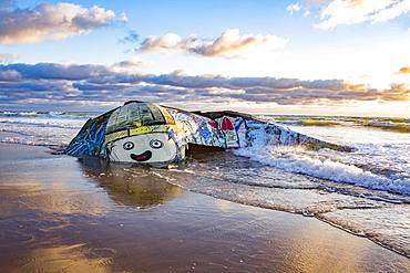 Colorfully painted bunker from the 2nd World War at high tide in the sea, Plage Gurp, Grayan-et-l`Hopital, Aquitaine, Gironde, France, Europe
