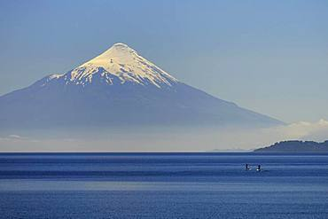 Volcano Osorno with snow cap at Lago Llanquihue, Region de los Lagos, Chile, South America