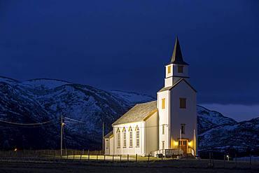 Illuminated church during blue hour, Brensholmen, Tromsoe, Troms, Norway, Europe