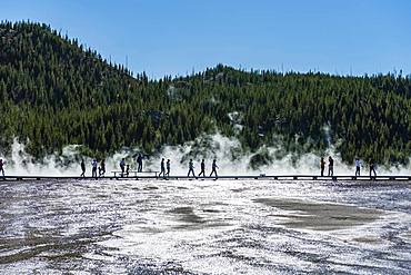 Tourists on a jetty in the thermal area, steaming hot spring, Grand Prismatic Spring, Midway Geyser Basin, Yellowstone National Park, Wyoming, USA, North America