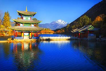 Chinese pagoda, Deyue Pavilion, reflected in Black Dragon Lake, Black Dragon Pool, in the background Jade Dragon Mountain, Unesco World Heritage Site, Lijiang, Yunnan Province, China, Asia
