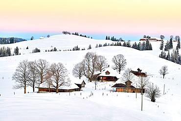 Farmhouses in snow-covered hilly landscape in the morning light, Schallenberg, Emmental, Canton Bern, Switzerland, Europe