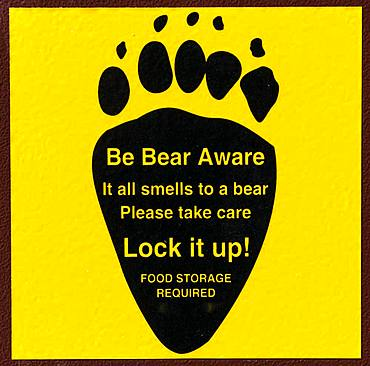 Be Bear Aware, Warning sign on a bear-proof dustbin, Grand Teton National Park, Wyoming, USA, North America