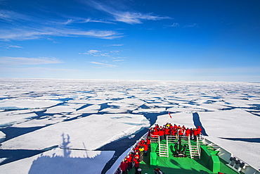 Expedition ship navigating through the pack ice in the Arctic, Svalbard, Norway, Europe