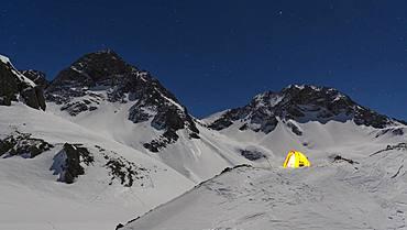Illuminated tent in the snow on the Maedelejoch, night shot, near Kemptner hut, Allgaeu Alps, Tyrol, Austria, Europe