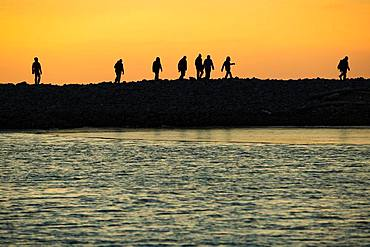 Backlit tourists, silhouette, sunset, Kobbefjord, Spitsbergen archipelago, Svalbard and Jan Mayen, Norway, Europe
