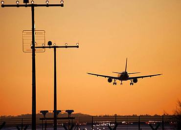 Approach aircraft at sunset, approach lighting, Duesseldorf Airport, Germany, Europe