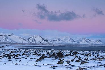 Snowy coastal landscape at dawn, south coast peninsula Snaefellsnes, Vesturland, Iceland, Europe