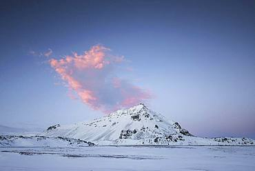 Snowy landscape, mountain with red cloud, south coast peninsula Snaefellsnes, Vesturland, Iceland, Europe