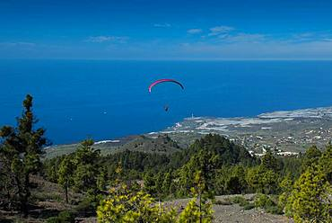Paragliding over the Caldera near Puerto Naos, West Coast, La Palma, Canary Islands, Spain, Europe