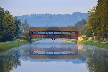 Wooden bridge over Isar channel, Aumuehle, Nature Reserve Isarauen near Egling, Upper Bavaria, Bavaria, Germany, Europe