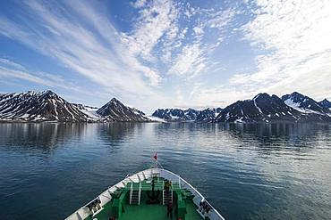 Expedition boat entering the Magdalenefjorden, Svalbard, Arctic, Norway, Europe
