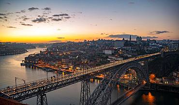 View over Porto with river Rio Douro and bridge Ponte Dom Luis I, Sunset, Porto, Portugal, Europe