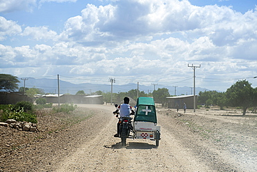 Emergency doctor on motorcycle with sidecar, Omo Valley, South Ethiopia