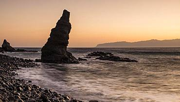 Beach Playa de Caleta with striking rocks and stones at sunrise, Playa de Caleta, La Gomera, Canary Islands, Spain, Europe