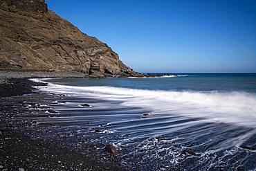 Black beach Playa de Caleta with rocks and stones, time exposure, Playa de Caleta, La Gomera, Canary Islands, Spain, Europe
