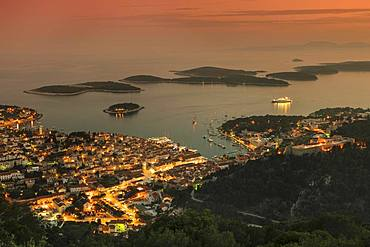 Town view Hvar with harbour and Pakleni islands at sunset, island Hvar, Dalmatia, Croatia, Europe