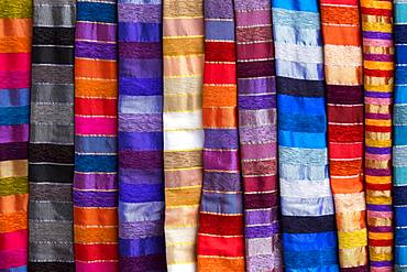Colorful striped cloths for sale at the street stall, Essaouira, Morocco, Africa