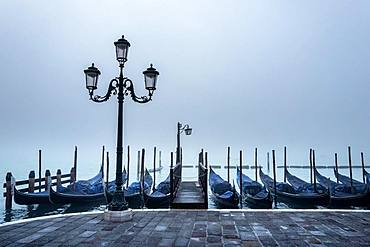 Gondolas in the fog at St Mark's Square, Venice, Italy, Europe