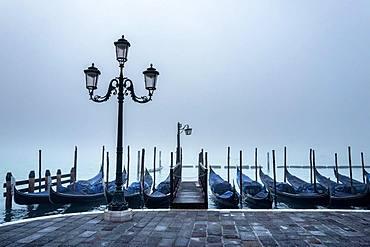 Gondolas in the fog at St Mark's Square, Venice, Italy, Europe